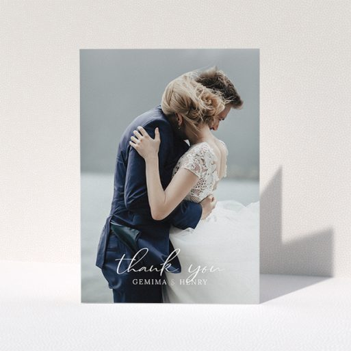 """A wedding thank you card template titled """"Classic Thank You"""". It is an A5 card in a portrait orientation. It is a photographic wedding thank you card with room for 1 photo. """"Classic Thank You"""" is available as a folded card, with mainly white colouring."""