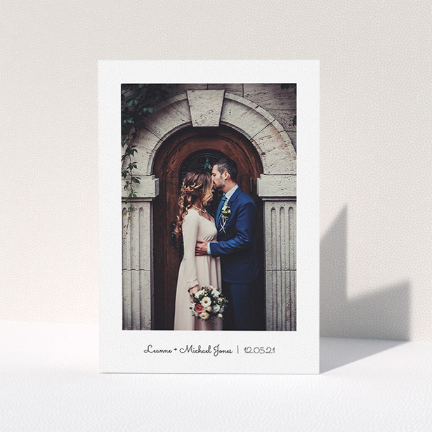 """A wedding thank you card design called """"Classic Thank You with Photo"""". It is an A5 card in a portrait orientation. It is a photographic wedding thank you card with room for 1 photo. """"Classic Thank You with Photo"""" is available as a folded card, with mainly white colouring."""