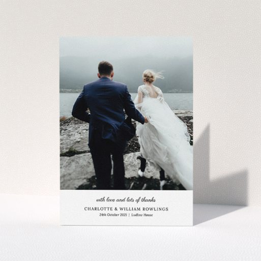 """A wedding thank you card template titled """"Classic Wedding Thanks"""". It is an A5 card in a portrait orientation. It is a photographic wedding thank you card with room for 1 photo. """"Classic Wedding Thanks"""" is available as a folded card, with mainly white colouring."""