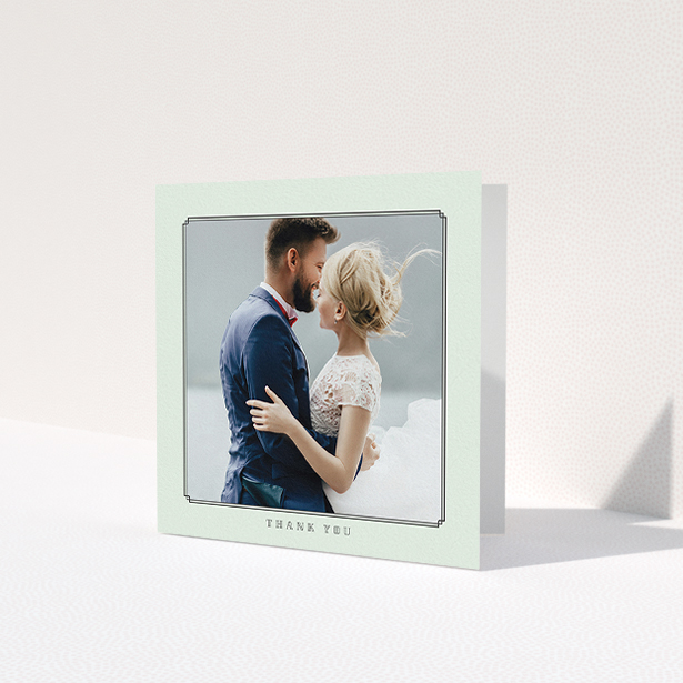 """A wedding thank you card design called """"Deco mint"""". It is a square (148mm x 148mm) card in a square orientation. It is a photographic wedding thank you card with room for 1 photo. """"Deco mint"""" is available as a folded card, with mainly green colouring."""