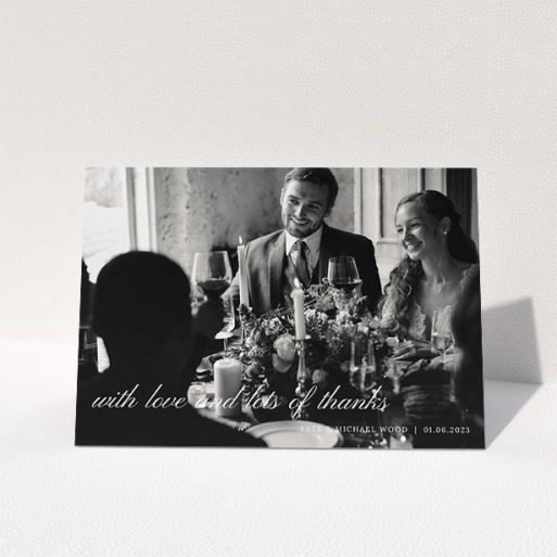 """A wedding thank you card called """"Elegant Photo Thanks"""". It is an A5 card in a landscape orientation. It is a photographic wedding thank you card with room for 1 photo. """"Elegant Photo Thanks"""" is available as a folded card, with mainly white colouring."""