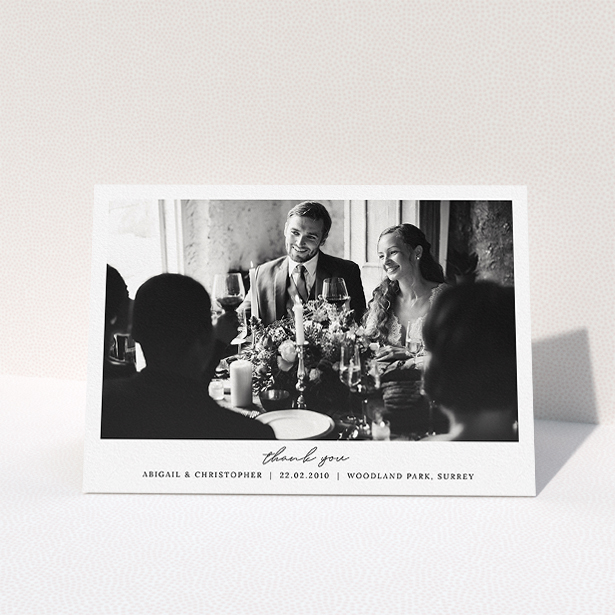 """A wedding thank you card template titled """"Everything You Need"""". It is an A5 card in a landscape orientation. It is a photographic wedding thank you card with room for 1 photo. """"Everything You Need"""" is available as a folded card, with mainly white colouring."""