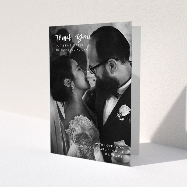 """A wedding thank you card design named """"Front Cover"""". It is an A5 card in a portrait orientation. It is a photographic wedding thank you card with room for 1 photo. """"Front Cover"""" is available as a folded card, with mainly white colouring."""