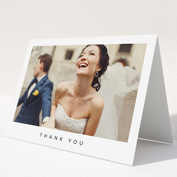 """A wedding thank you card design titled """"Full-page landscape"""". It is an A5 card in a landscape orientation. It is a photographic wedding thank you card with room for 1 photo. """"Full-page landscape"""" is available as a folded card, with mainly white colouring."""