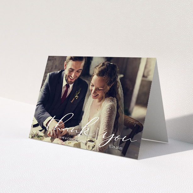 """A wedding thank you card design called """"Handwritten Thanks"""". It is an A5 card in a landscape orientation. It is a photographic wedding thank you card with room for 1 photo. """"Handwritten Thanks"""" is available as a folded card, with mainly white colouring."""
