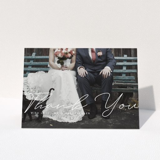 """A wedding thank you card design named """"Hermes"""". It is an A5 card in a landscape orientation. It is a photographic wedding thank you card with room for 1 photo. """"Hermes"""" is available as a folded card, with mainly white colouring."""