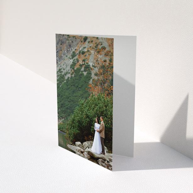 """A wedding thank you card design called """"Intro-Thanks-Photo"""". It is an A5 card in a portrait orientation. It is a photographic wedding thank you card with room for 1 photo. """"Intro-Thanks-Photo"""" is available as a folded card, with mainly white colouring."""