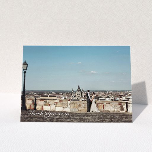 """A wedding thank you card named """"Italianno"""". It is an A5 card in a landscape orientation. It is a photographic wedding thank you card with room for 1 photo. """"Italianno"""" is available as a folded card, with mainly white colouring."""