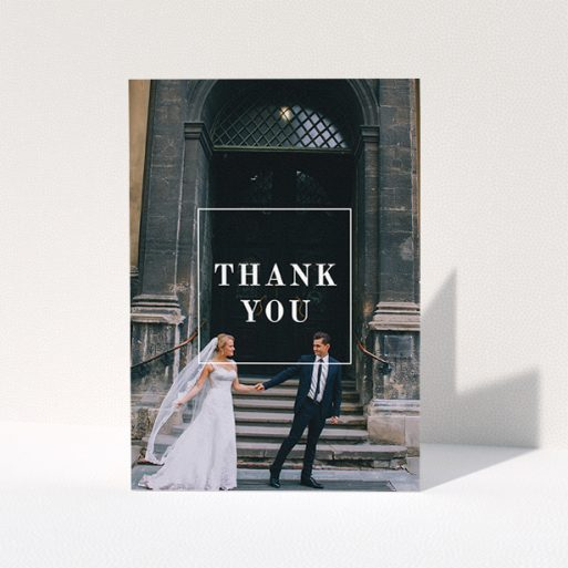 """A wedding thank you card template titled """"Just the outline"""". It is an A5 card in a portrait orientation. It is a photographic wedding thank you card with room for 1 photo. """"Just the outline"""" is available as a folded card, with mainly white colouring."""