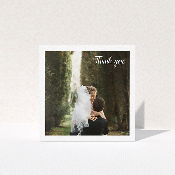 """A wedding thank you card template titled """"Just the two of us"""". It is a square (148mm x 148mm) card in a square orientation. It is a photographic wedding thank you card with room for 1 photo. """"Just the two of us"""" is available as a folded card, with mainly white colouring."""