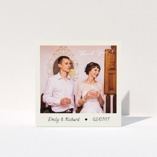 """A wedding thank you card named """"Keepsake"""". It is a square (148mm x 148mm) card in a square orientation. It is a photographic wedding thank you card with room for 1 photo. """"Keepsake"""" is available as a folded card, with tones of cream and navy blue."""