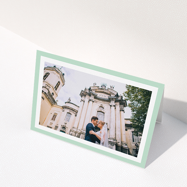 """A wedding thank you card design called """"Light Green Border"""". It is an A5 card in a landscape orientation. It is a photographic wedding thank you card with room for 1 photo. """"Light Green Border"""" is available as a folded card, with tones of green and white."""