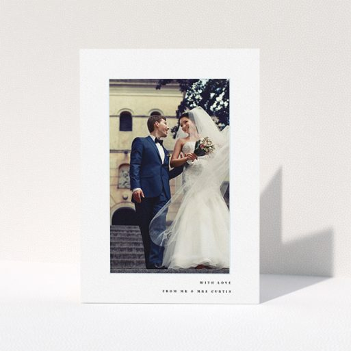 """A wedding thank you card design named """"Little blue border"""". It is an A5 card in a portrait orientation. It is a photographic wedding thank you card with room for 1 photo. """"Little blue border"""" is available as a folded card, with mainly white colouring."""