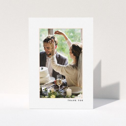 """A wedding thank you card template titled """"Little pink border"""". It is an A5 card in a portrait orientation. It is a photographic wedding thank you card with room for 1 photo. """"Little pink border"""" is available as a folded card, with mainly white colouring."""