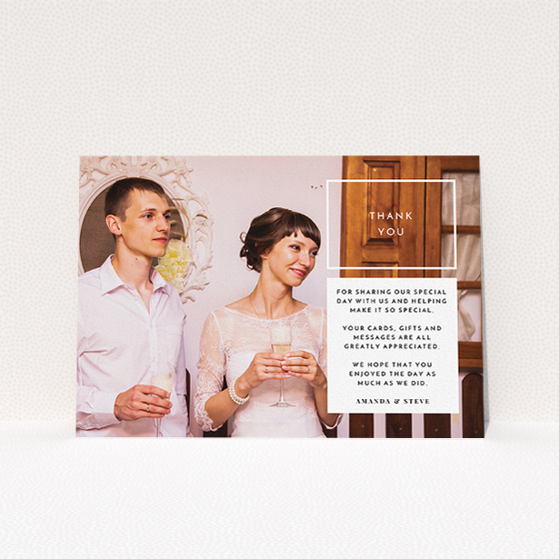 """A wedding thank you card design named """"Little white box"""". It is an A5 card in a landscape orientation. It is a photographic wedding thank you card with room for 1 photo. """"Little white box"""" is available as a flat card, with mainly white colouring."""