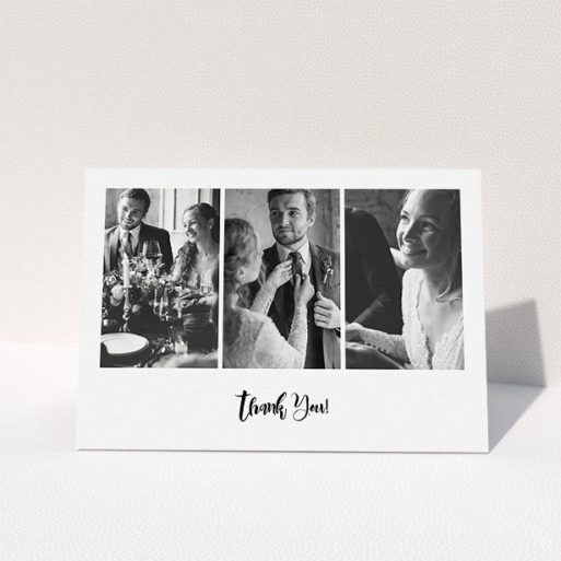 """A wedding thank you card design titled """"Modern Tryptic"""". It is an A5 card in a landscape orientation. It is a photographic wedding thank you card with room for 3 photos. """"Modern Tryptic"""" is available as a folded card, with mainly white colouring."""