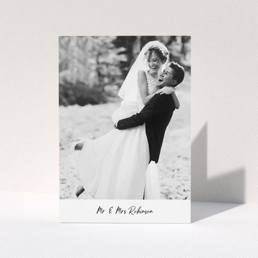 """A wedding thank you card design titled """"Mr & Mrs Footer"""". It is an A5 card in a portrait orientation. It is a photographic wedding thank you card with room for 1 photo. """"Mr & Mrs Footer"""" is available as a folded card, with mainly white colouring."""