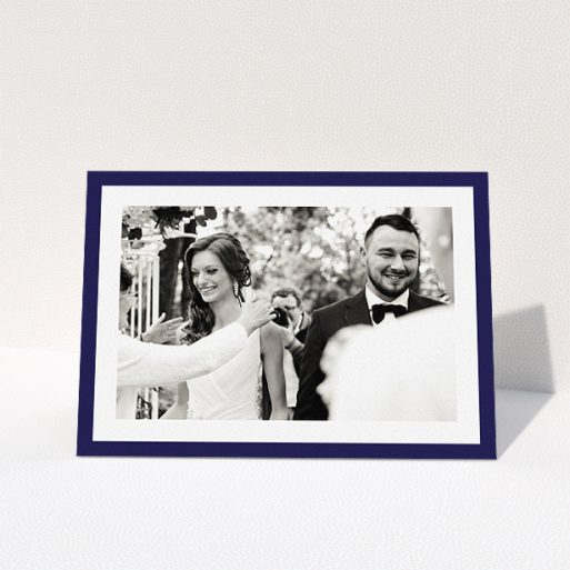 """A wedding thank you card named """"Navy Border"""". It is an A5 card in a landscape orientation. It is a photographic wedding thank you card with room for 1 photo. """"Navy Border"""" is available as a folded card, with tones of blue and white."""
