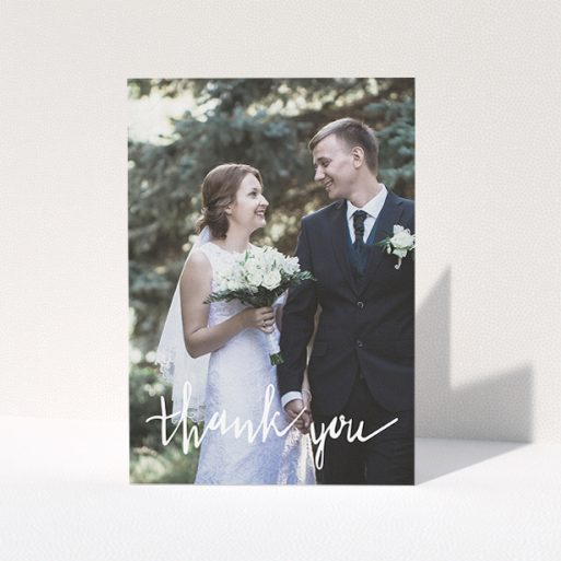 """A wedding thank you card called """"New to calligraphy"""". It is an A5 card in a portrait orientation. It is a photographic wedding thank you card with room for 1 photo. """"New to calligraphy"""" is available as a folded card, with mainly white colouring."""
