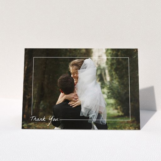 """A wedding thank you card called """"On Photo Border"""". It is an A5 card in a landscape orientation. It is a photographic wedding thank you card with room for 1 photo. """"On Photo Border"""" is available as a folded card, with mainly white colouring."""