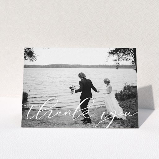 """A wedding thank you card template titled """"One Photo"""". It is an A5 card in a landscape orientation. It is a photographic wedding thank you card with room for 1 photo. """"One Photo"""" is available as a folded card, with mainly white colouring."""