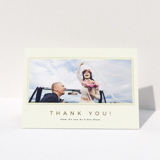 """A wedding thank you card called """"One white Polaroid """". It is an A5 card in a landscape orientation. It is a photographic wedding thank you card with room for 1 photo. """"One white Polaroid """" is available as a folded card, with mainly cream colouring."""