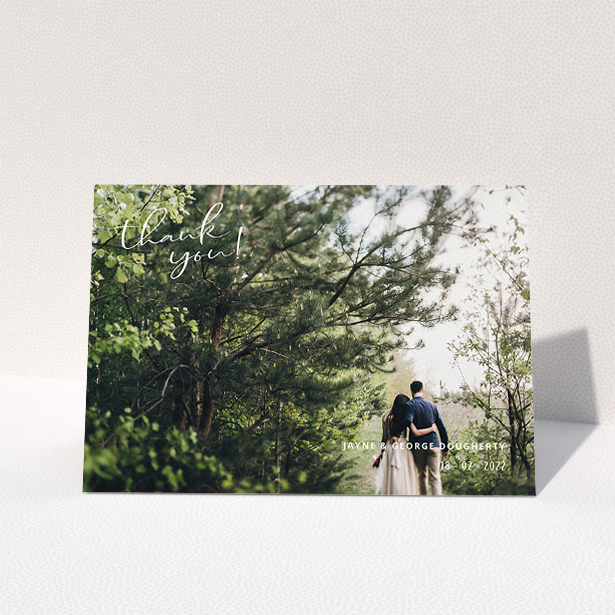"""A wedding thank you card design called """"Opposite Photo Corners"""". It is an A5 card in a landscape orientation. It is a photographic wedding thank you card with room for 1 photo. """"Opposite Photo Corners"""" is available as a folded card, with mainly white colouring."""