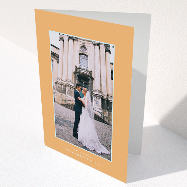 """A wedding thank you card design called """"Orange and blue"""". It is an A5 card in a portrait orientation. It is a photographic wedding thank you card with room for 1 photo. """"Orange and blue"""" is available as a folded card, with tones of orange and blue."""