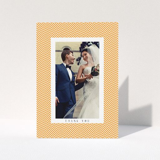 """A wedding thank you card design called """"Orange Houndstooth"""". It is an A6 card in a portrait orientation. It is a photographic wedding thank you card with room for 1 photo. """"Orange Houndstooth"""" is available as a folded card, with tones of orange and white."""