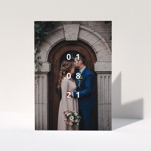 """A wedding thank you card called """"Our Date"""". It is an A5 card in a portrait orientation. It is a photographic wedding thank you card with room for 1 photo. """"Our Date"""" is available as a folded card, with mainly white colouring."""