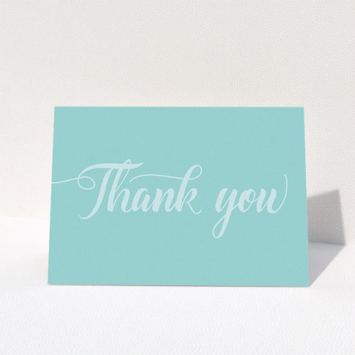 """A wedding thank you card template titled """"Pastel blue calligraphy"""". It is an A5 card in a landscape orientation. """"Pastel blue calligraphy"""" is available as a folded card, with mainly blue colouring."""
