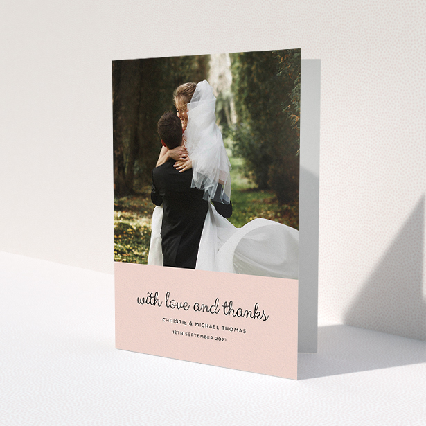 """A wedding thank you card template titled """"Pink Footer"""". It is an A5 card in a portrait orientation. It is a photographic wedding thank you card with room for 1 photo. """"Pink Footer"""" is available as a folded card, with mainly pink colouring."""