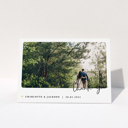 """A wedding thank you card design called """"Rounded-Off with Thanks"""". It is an A6 card in a landscape orientation. It is a photographic wedding thank you card with room for 1 photo. """"Rounded-Off with Thanks"""" is available as a folded card, with mainly white colouring."""