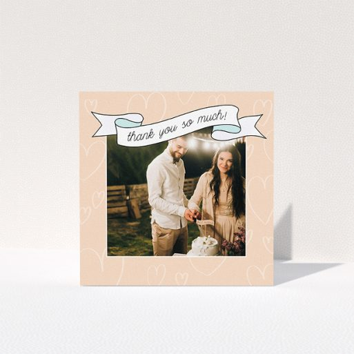 """A wedding thank you card named """"Rustic Thank You"""". It is a square (148mm x 148mm) card in a square orientation. It is a photographic wedding thank you card with room for 1 photo. """"Rustic Thank You"""" is available as a folded card, with tones of faded yellow and light blue."""