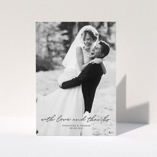 """A wedding thank you card design named """"Script & Serif"""". It is an A5 card in a portrait orientation. It is a photographic wedding thank you card with room for 1 photo. """"Script & Serif"""" is available as a folded card, with mainly black colouring."""