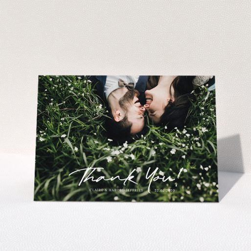 """A wedding thank you card template titled """"Simple Appreciation"""". It is an A5 card in a landscape orientation. It is a photographic wedding thank you card with room for 1 photo. """"Simple Appreciation"""" is available as a folded card, with mainly white colouring."""