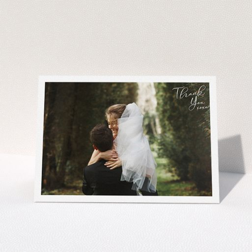 """A wedding thank you card named """"Simple Landscape Thanks"""". It is an A5 card in a landscape orientation. It is a photographic wedding thank you card with room for 1 photo. """"Simple Landscape Thanks"""" is available as a folded card, with mainly white colouring."""