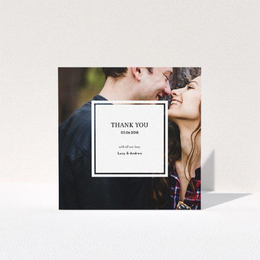 """A wedding thank you card called """"Simple little square"""". It is a square (148mm x 148mm) card in a square orientation. It is a photographic wedding thank you card with room for 1 photo. """"Simple little square"""" is available as a folded card, with mainly white colouring."""