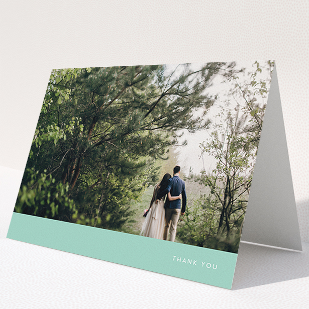 """A wedding thank you card called """"Simple Mint"""". It is an A5 card in a landscape orientation. It is a photographic wedding thank you card with room for 1 photo. """"Simple Mint"""" is available as a folded card, with tones of green and white."""