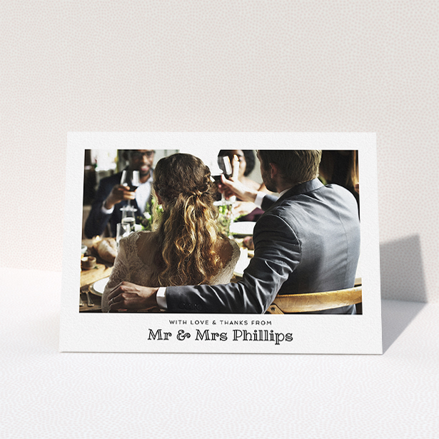 """A wedding thank you card called """"Simple Photo Frame"""". It is an A5 card in a landscape orientation. It is a photographic wedding thank you card with room for 1 photo. """"Simple Photo Frame"""" is available as a folded card, with mainly white colouring."""