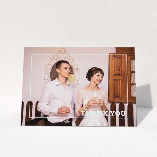 """A wedding thank you card named """"Simple Thank You Frame"""". It is an A6 card in a landscape orientation. It is a photographic wedding thank you card with room for 1 photo. """"Simple Thank You Frame"""" is available as a folded card, with mainly white colouring."""