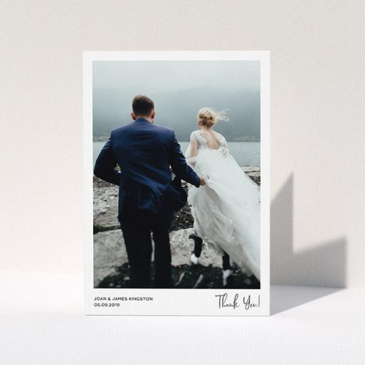 """A wedding thank you card design titled """"Simple Wedding Thank You"""". It is an A5 card in a portrait orientation. It is a photographic wedding thank you card with room for 1 photo. """"Simple Wedding Thank You"""" is available as a folded card, with mainly white colouring."""