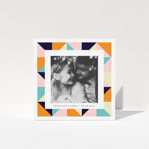 """A wedding thank you card named """"Sloane Squares"""". It is a square (148mm x 148mm) card in a square orientation. It is a photographic wedding thank you card with room for 1 photo. """"Sloane Squares"""" is available as a folded card, with tones of pink, orange and navy blue."""