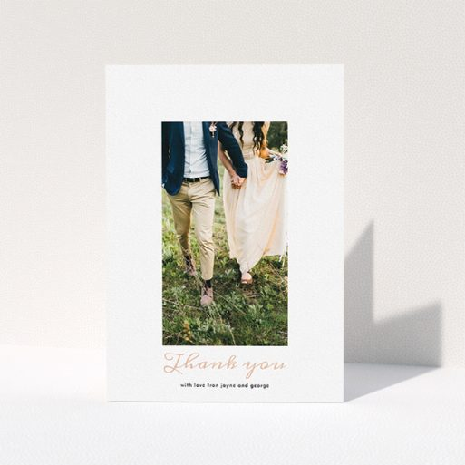 """A wedding thank you card called """"Small and Central"""". It is an A5 card in a portrait orientation. It is a photographic wedding thank you card with room for 1 photo. """"Small and Central"""" is available as a folded card, with tones of white and pink."""