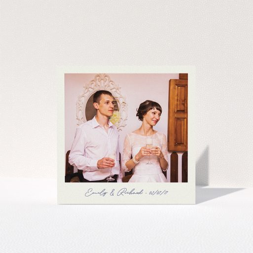 """A wedding thank you card called """"Snapshot"""". It is a square (148mm x 148mm) card in a square orientation. It is a photographic wedding thank you card with room for 1 photo. """"Snapshot"""" is available as a folded card, with tones of white and Navy blue."""