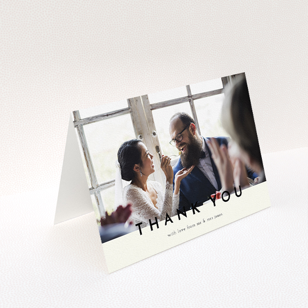 """A wedding thank you card design called """"Split thank you """". It is an A5 card in a landscape orientation. It is a photographic wedding thank you card with room for 1 photo. """"Split thank you """" is available as a folded card, with mainly cream colouring."""