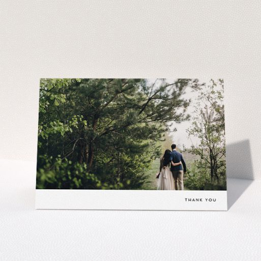 """A wedding thank you card design called """"Thankful with Simplicity"""". It is an A5 card in a landscape orientation. It is a photographic wedding thank you card with room for 1 photo. """"Thankful with Simplicity"""" is available as a folded card, with mainly white colouring."""