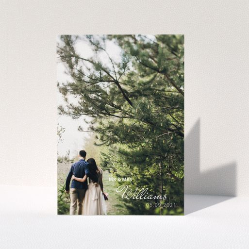 """A wedding thank you card named """"Thanks Bottom-Right"""". It is an A5 card in a portrait orientation. It is a photographic wedding thank you card with room for 1 photo. """"Thanks Bottom-Right"""" is available as a folded card, with mainly white colouring."""