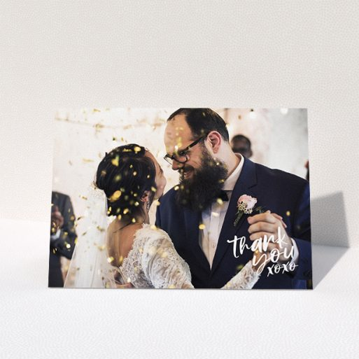"""A wedding thank you card design called """"Thanks In the Corner"""". It is an A5 card in a landscape orientation. It is a photographic wedding thank you card with room for 1 photo. """"Thanks In the Corner"""" is available as a folded card, with mainly white colouring."""