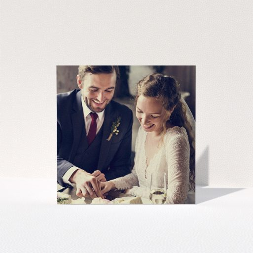 """A wedding thank you card design named """"Thanks with Just a Square Photo"""". It is a square (148mm x 148mm) card in a square orientation. It is a photographic wedding thank you card with room for 1 photo. """"Thanks with Just a Square Photo"""" is available as a folded card."""